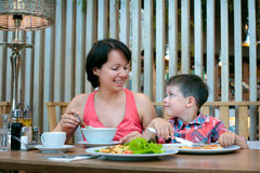 Mother and son having lunch together at the mall. And smiling Stock Image