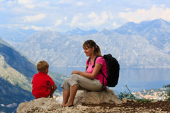 Mother and son having rest in mountains Royalty Free Stock Images