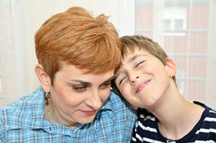Mother and son with head to head Royalty Free Stock Photography