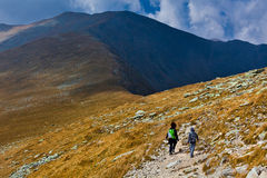Mother and son hiking into the mountains Royalty Free Stock Photo
