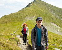 Mother and son hiking in the mountains Royalty Free Stock Photo