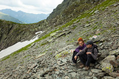 Mother and son hiking in the mountains Stock Images