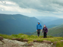 Mother and son hiking in the mountains Royalty Free Stock Images