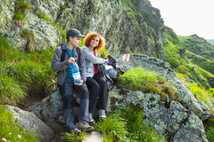 Mother and son hiking in the mountains Stock Photo
