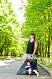 Mother and son hitchhiking Stock Image