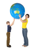 Mother and son holding big inflatable globe Stock Image