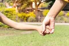 Mother and son holding hand stock photos