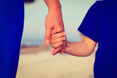 Mother and son holding hands on the beach Royalty Free Stock Photo