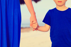 Mother and son holding hands on beach Royalty Free Stock Image