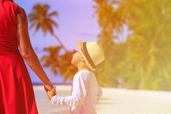 Mother and son holding hands on beach Royalty Free Stock Photo