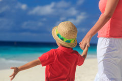 Mother and son holding hands on beach vacation Royalty Free Stock Images