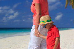 Mother and son holding hands on beach vacation. Mother and son holding hands on tropical beach vacation stock images