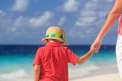 Mother and son holding hands on beach vacation Royalty Free Stock Photography