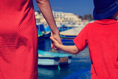 Mother and son holding hands in the port Stock Photos