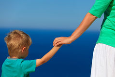 Mother and son holding hands on vacation. Family vacation concept Royalty Free Stock Photos