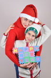Mother and son holding a Happy New Year sign. Made of alphabet puzzle pieces stock images