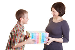 Mother and son holding a present Stock Images