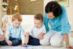 Mother and son at home on the floor. Young mother having fun with her little son at home on the floor royalty free stock photo