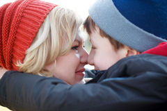 Mother and son huddle together winter portrait Stock Photos