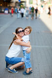 Mother and son hugging. Loving mother and son hugging outdoors royalty free stock photo