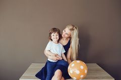 Mother and son are hugging on the background for the text. Mothers Day royalty free stock images