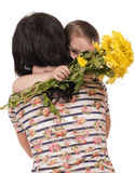 Mother and son hugging with flowers Royalty Free Stock Photo