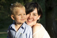 Mother and son hugging Royalty Free Stock Image