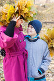 Mother and son hugging. In the park in autumn Stock Images