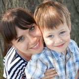 Mother and son are hugging. And smiling Royalty Free Stock Images
