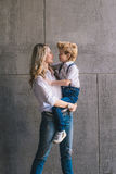 Mother and son hugging. On the wall background royalty free stock photos