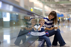 Mother and son at an international airport Royalty Free Stock Photos