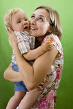 Mother and  Son isolated on green. Royalty Free Stock Photos