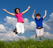 Mother and son jumping Stock Photography