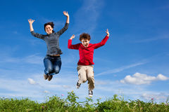 Mother and son jumping royalty free stock photos