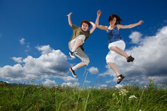 Mother and son jumping Royalty Free Stock Photo
