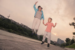 Mother son  jumping Royalty Free Stock Photography