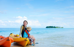 Mother and son after kayaking stock images