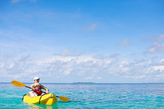 Mother and son kayaking royalty free stock photography
