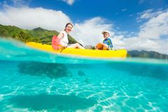 Mother and son kayaking stock photos