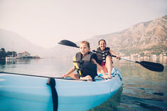 Mother and son kayaking royalty free stock photo