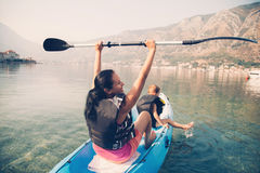 Mother and son kayaking stock image