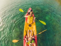 Mother and son kayaking at tropical ocean royalty free stock photos