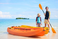Mother and son with kayaks Stock Photo
