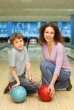 Mother and son keep balls in bowling club Stock Photography