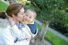 Mother and Son Kiss. A mother kissing her son with love Royalty Free Stock Photo