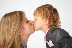 Mother and son kiss Royalty Free Stock Photo