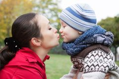 Mother and son kissing. In autumn park Stock Image