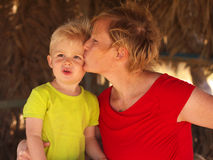 Mother and son. Mother kissing three years old son Royalty Free Stock Image