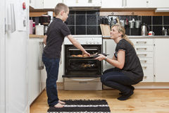 Mother and son in kitchen Stock Image