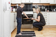 Mother and son in kitchen Stock Images